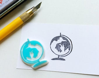 Globe stamp. Rubber stamp. Hand carved stamp. Mounted