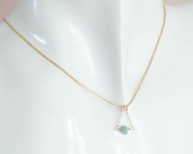 Tiny emerald pendant, May birthstone