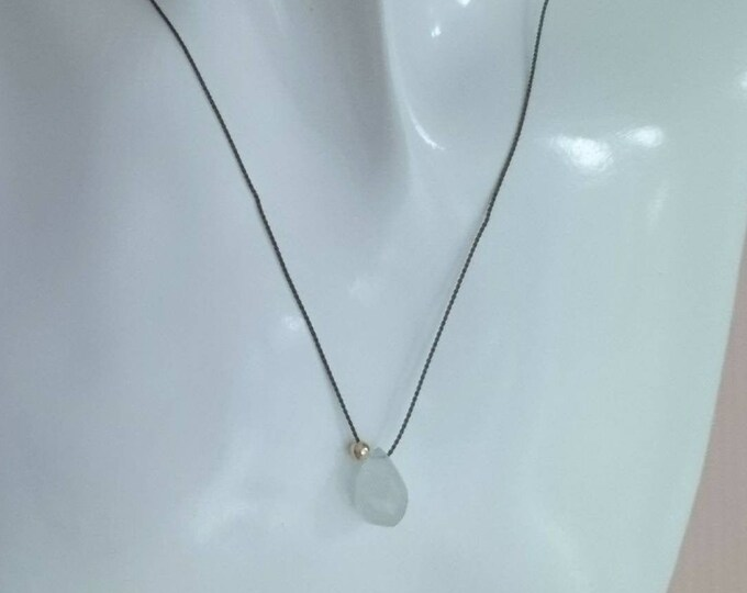 Aquamarine pendant, brown silk cord with faceted raw aquamarine teardrop