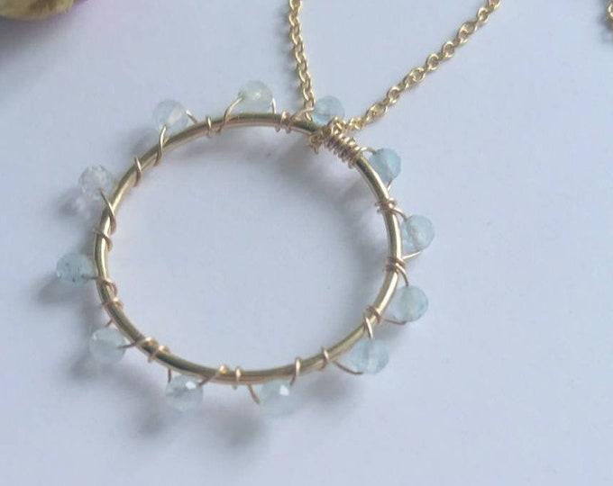 Faceted aquamarine circle pendant in 14k gold fill,