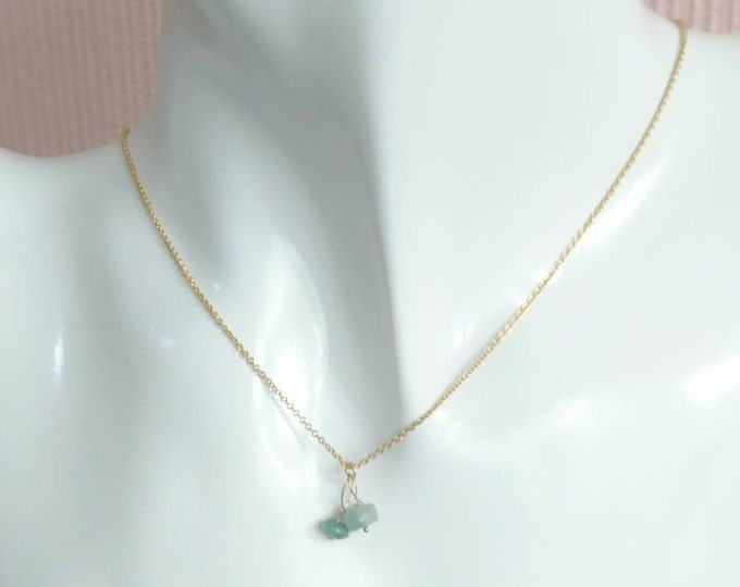 Chain with two tiny faceted raw emerald charms