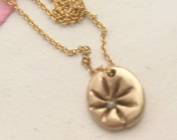 Flower pendant with raw white diamond