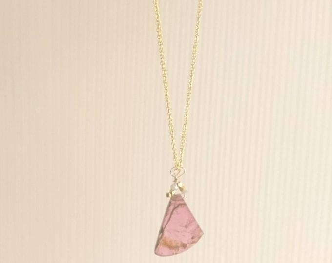 Pink tourmaline pendant with raw pink diamonds
