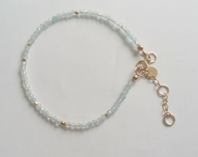 Faceted aquamarine bracelet with 7 yellow gold vermeil style nuggets and personalised tag