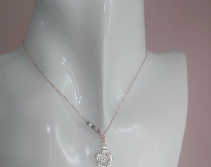 Flower pendant on pink silk cord