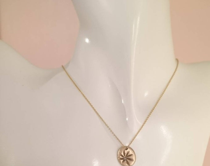 Wildflower pendant, bronze charm with flower design and a raw faceted white solitaire diamond