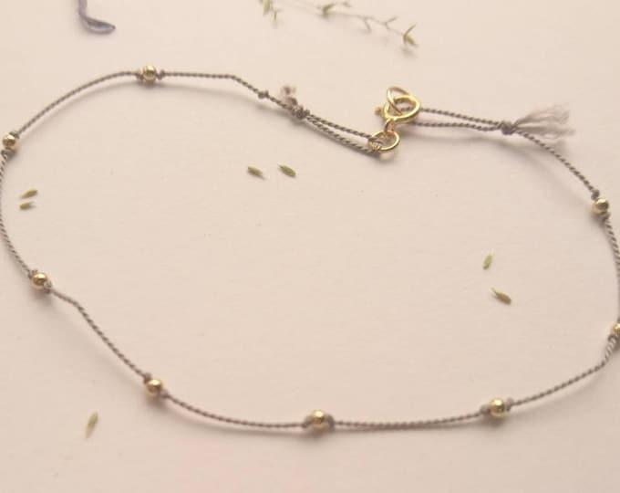 Gold beaded cord bracelet, silk cord bracelet with 14k gold beads