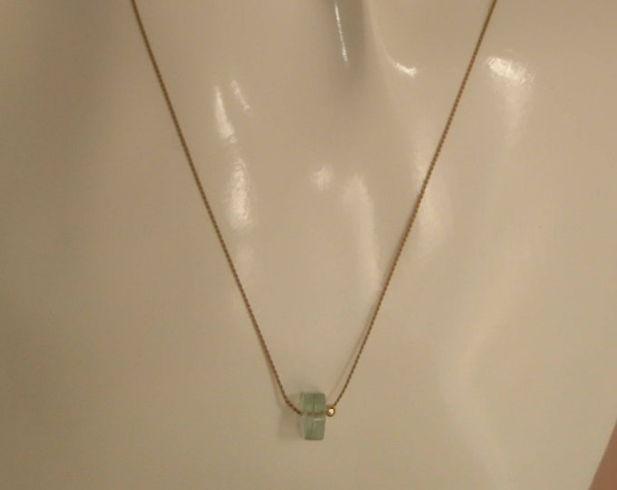 Aquamarine on silk cord with 14k gold smooth bead