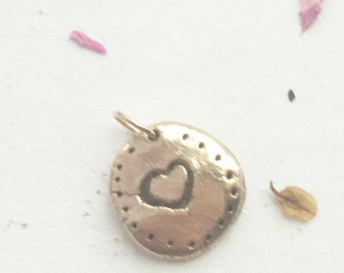Handmade bronze charm with heart detail