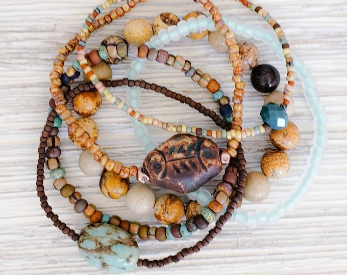 Hippie chic style stack bracelets for women with a gorgeous natural turquoise bead. Earthy feeling boho jewelry.
