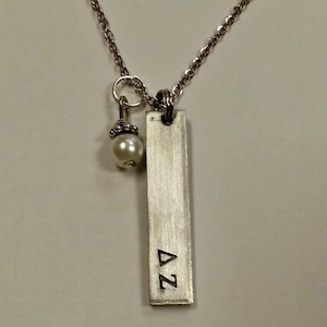 comes on an 18 inch stainless steel link chain ZTA necklace Zeta Tau Alpha Handstamped Bar Charm Necklace