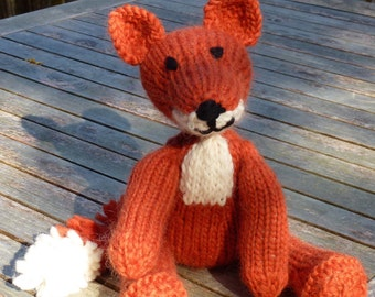 Knitting Pattern (US) for Freddie Fox - an adorable knitted fox.  Worked in stocking stitch with a pom pom tail.  Knit flat or in the round
