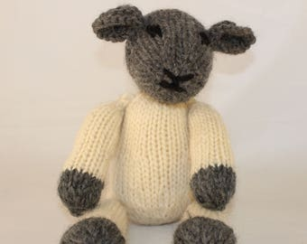Knitting Pattern (US) for Lucy Lamb - a cute black-face knitted lamb. Worked in stocking stitch with plaited tail. Knit flat or in the round