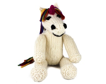KNITTING PATTERN (US terms) Ulysses Unicorn Toy. Easy knitting pattern for a cuddly unicorn toy. Knit flat or in the round. Pdf download.