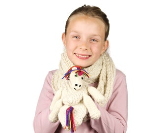 Ulysses Unicorn Scarf Knitting Pattern (US). Child's scarf with a simple cable pattern, hand warming pockets and unicorn toy. Pdf download.