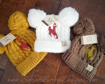 348c13520be31 Kids Wyoming Cowboys Double Pom CC Beanies with Bucking Horse and Rider -  Brown and Gold - Steamboat - 307 - UW - Go Pokes