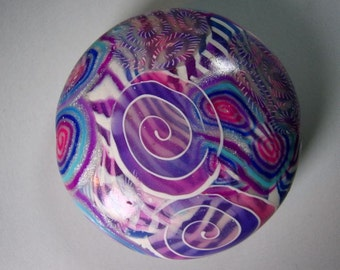Beautiful, Shiny, round Polymer clay pendent. Made with layers of  thinly sliced canes in shades of purple and blue.