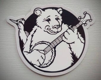 Magnet. Big Steve on Banjo Logo. 3x2.43 inch. Refrigerator Magnet. Banjo art. Bear art. Spirit Animals. Banjo. Bluegrass music. Music lover.