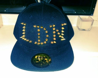 Black and gold Spiked LDN Snapback