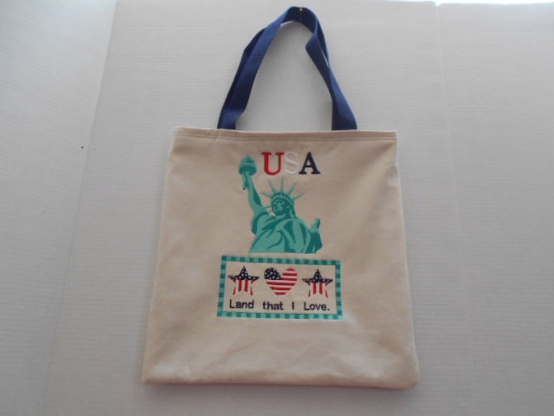 Patriotic Tote Bag The statue of liberty and stars and stripes highlight this beautiful patriotic tote bag.
