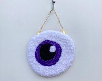 Eyeball purple tufted wall hanging