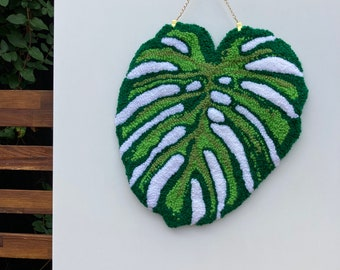 Monstera leaf tufted wall hanging
