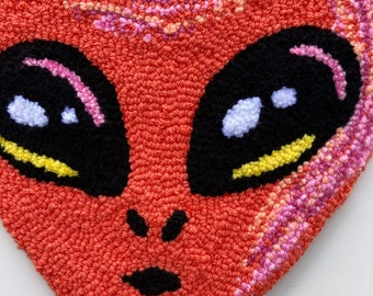 Alien head pink tufted wall hanging