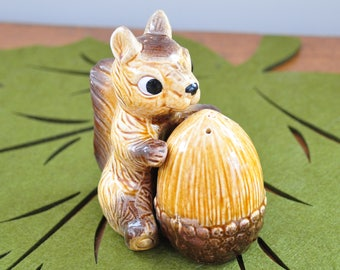 Vintage squirrel with nut salt and pepper set.  Cute and useful! This little guy is holding onto his nut.  Made in Japan