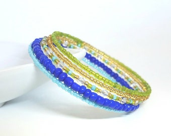 Memory wire bracelet. Lime green and gold seed beads with shades of blue. Swarovski crystals. Wrap bracelet
