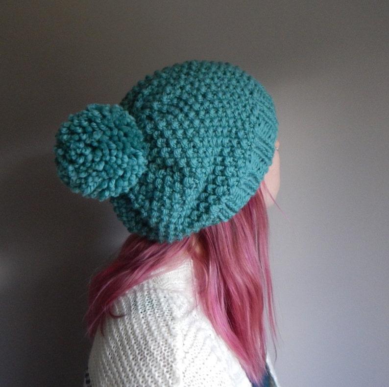 779321630cb Super slouchy knit beanie with a pom pom teal blue wool knit