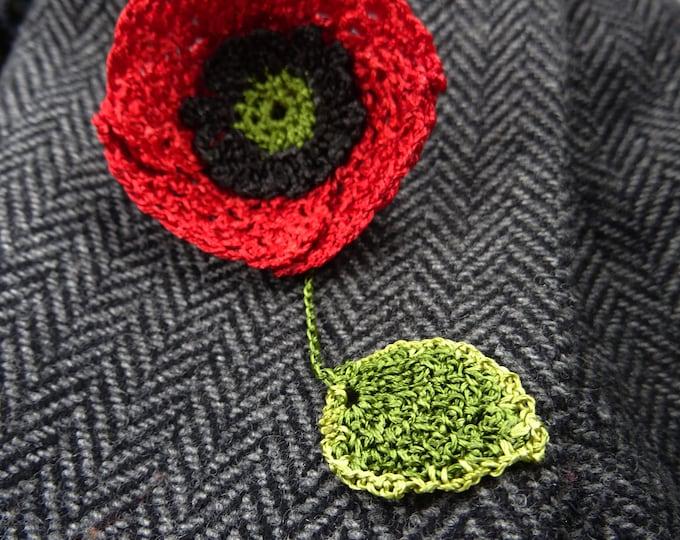 Crochet poppy brooch