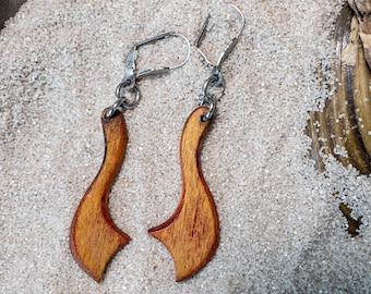 beautiful pair of light earrings made of multi-layered glued birch wood.