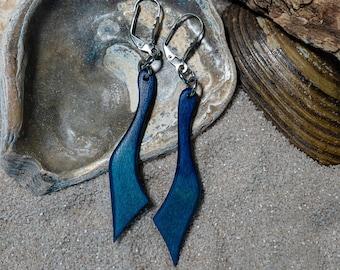 beautiful light pair of earrings made of multi-layered glued birch wood in blue petrol.