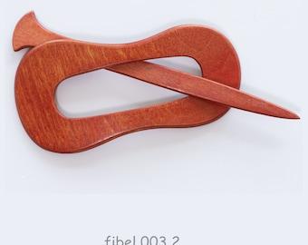 003 Fibula and hair clip made of wood, like Photo