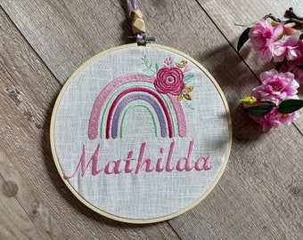 Embroidery frame with name and rainbow on linen