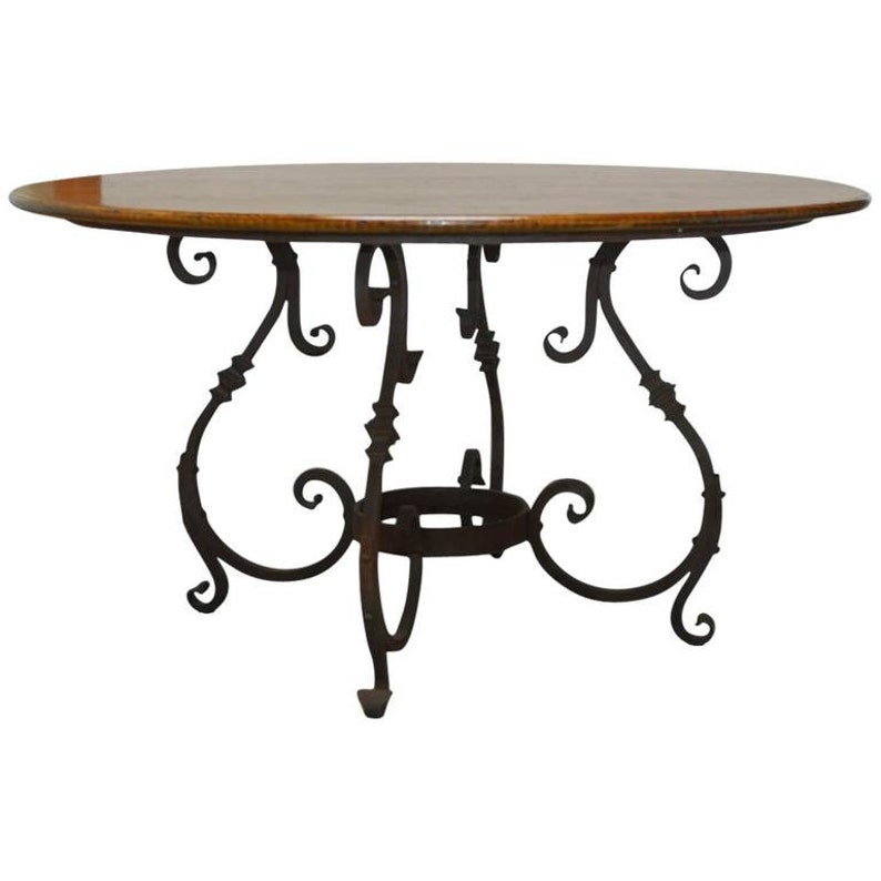 Wrought Iron Round Table.Italian Oak And Scrolled Iron Round Dining Table