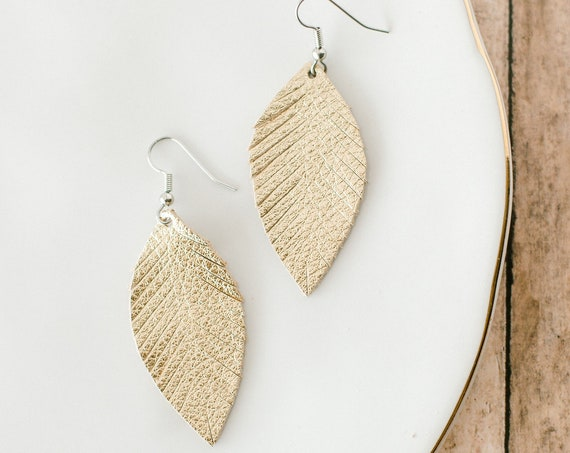 Gold feather leather earrings. Womens small gold leather earrings.