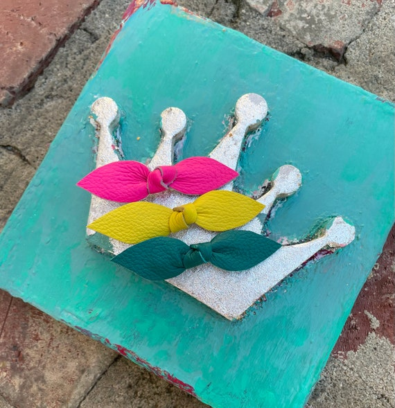 Leather know hair clips in neon pink, yellow and dark teal. Set of three
