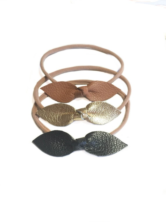 Leather baby knot leather headbands in gold, caramel and black on nylon