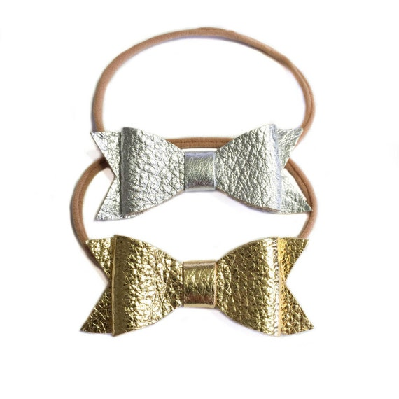 Newborn baby leather nylon headbands in silver and gold.
