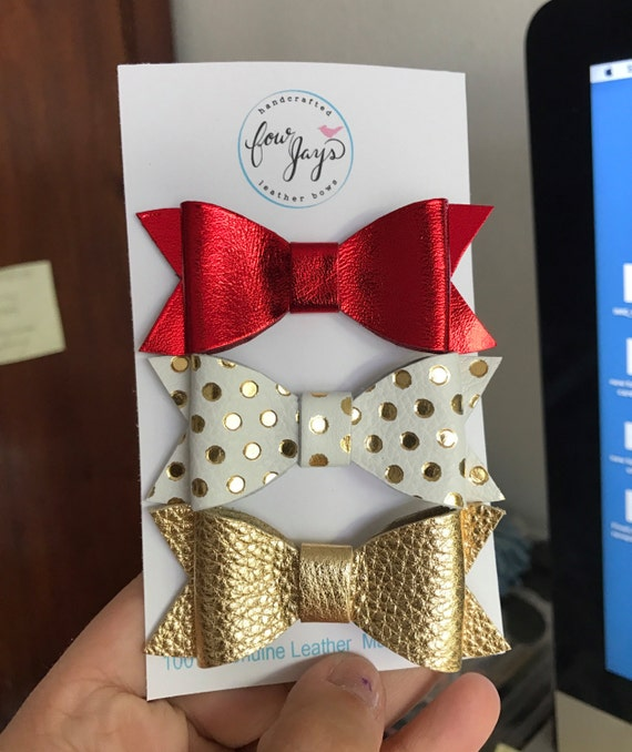 Christmas Leather hair bows in metallic red, gold polka dots and gold.