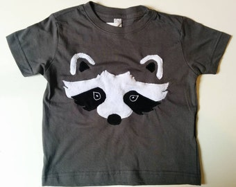Raccoon tee shirt for kids, nocturnal creature in negative space