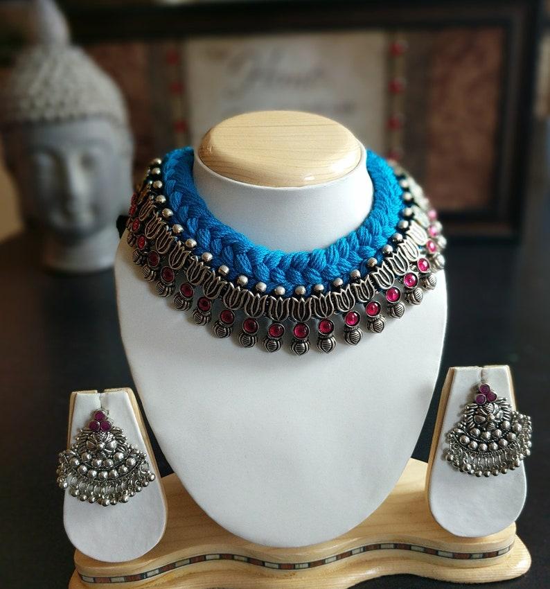 Dazzling blue thread Ruby stone necklace with amazing Grand stone earringslambani necklace set