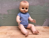 Vintage Collectible Hard Plastic Jointed Baby Doll With Sculpted Hair And Painted Face