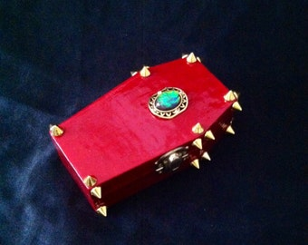 Glittering Red And Gold Spiked Laughing Coffin Box With Opal Like Stone