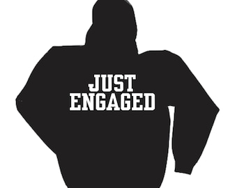 Just Engaged- unisex oversized sweatshirt with pockets - enagement Gifts- Black sweatshirt reads Just Engaged