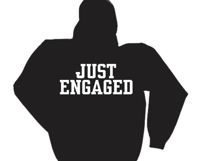 Just Engaged- unisex oversized sweatshirt with pockets - enagement Gifts- Black sweatshirt reads Just Engaged