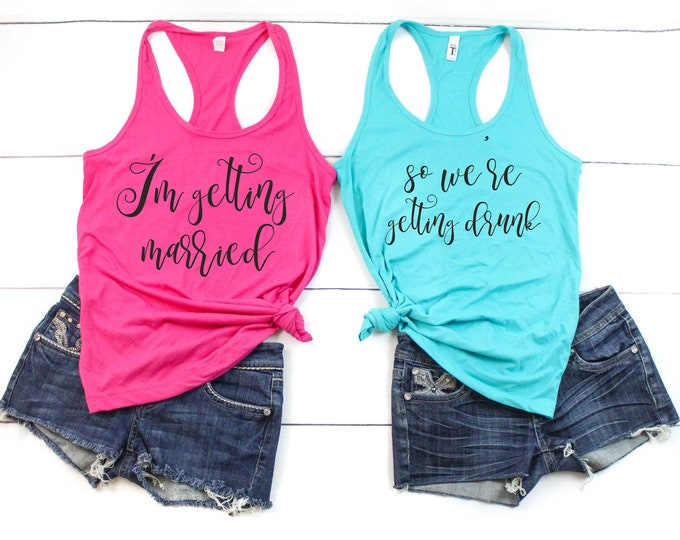 I'm getting married , so we're getting drunk bachelorette party shirts , bridal t-shirts, bridesmaid shirt, funny bach beach drinking tanks