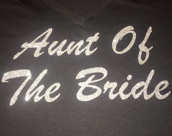 Aunt of the bride shirt . Personalized bridesmaid shirts . Bridesmaid title shirt. Short sleeve v neck bridesmaid glitter shirt.