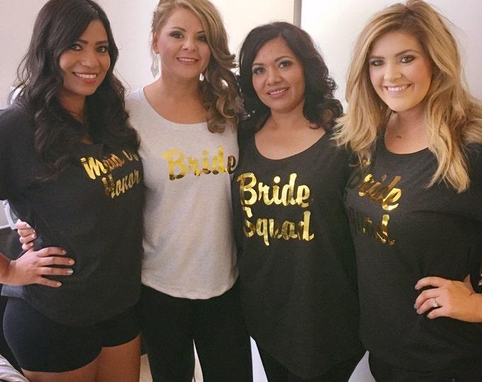 Set of 9 gold oversized shirts. Bridal Party wide neck shirts. Ladies bridesmaid shirts. Bridesmaid gifts. Gold vinyl bridesmaid shirts.